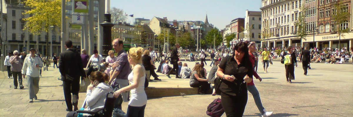 Urban plaza with lots of people in Nottingham, England